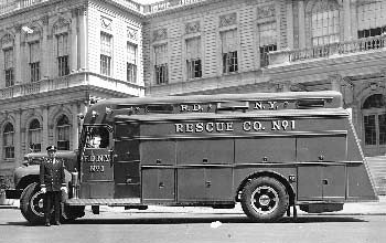 FDNY Rescue 1  1959 Mack. New York.  A new Rescue 1 is parked outside of City Hall.