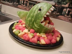 I was so inspired by this awesome tutorial  for a shark-shaped watermelon sculpture that I decided to try it myself. I brought the fruit sa...