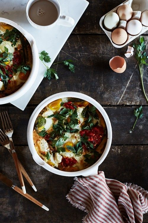 Baked Eggs with Harissa & Goat Cheese recipe. Now available on the Anthropologie EU Blog.