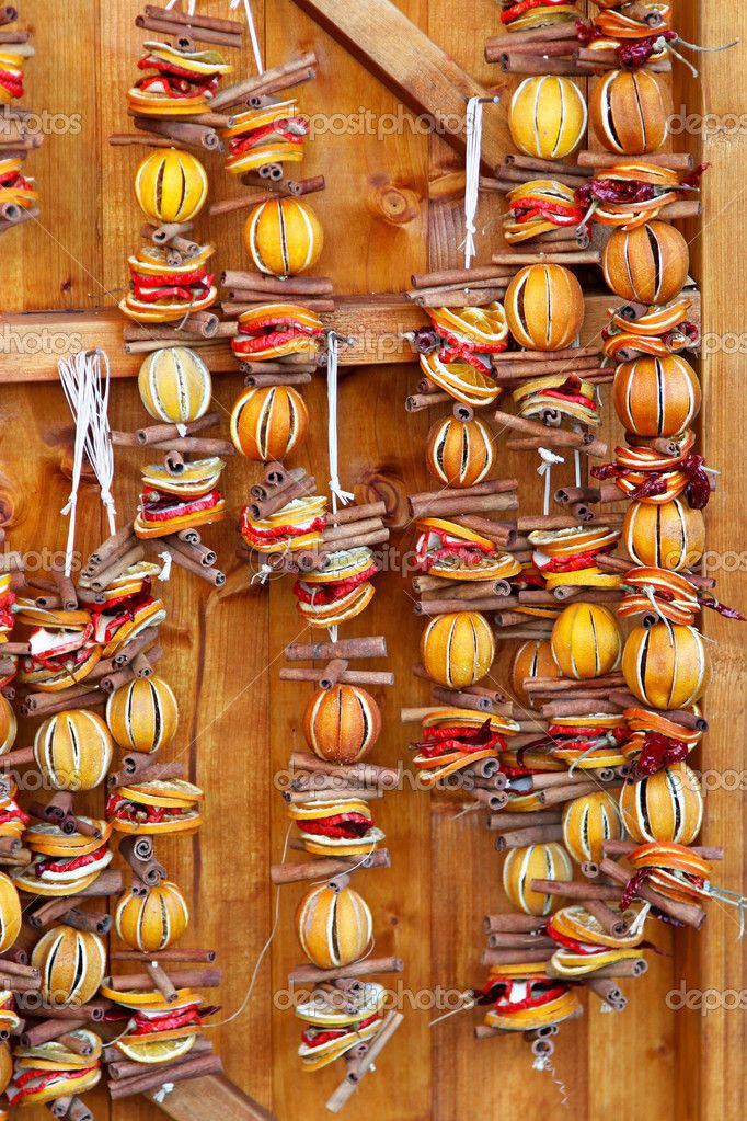 Wall Christmas decoration made of dried orange garlands