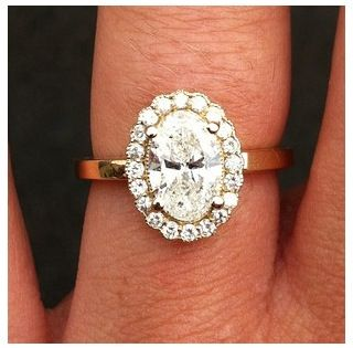 Oval wedding ring. I love the stone with the halo but dislike the band. I prefer little stones around the band too.