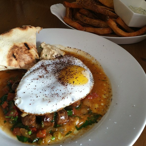 Kanella - Greek Cypriot restaurant featured on Diners Drive-Ins & Dives - try the Pan fried homemade lamb Merguez sausage with duck egg, pita and spicy yogurt for a delicious breakfast.