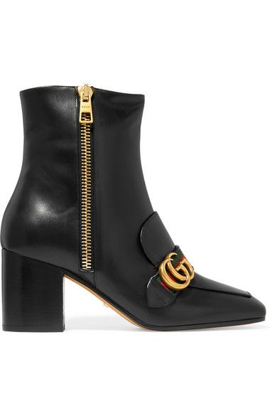 Gucci's ankle boots have been flawlessly made in Italy from smooth black leather with a stable block heel and square toe. They're finished with the label's unmistakable interlocking 'GG' plaque and red and green webbing - originally inspired by equestrian saddle straps. We'll be wearing ours with everything from dresses to denim.