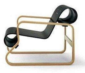 Alivar Aalto designed the Paimio Chair in 1932-33, which revolutionized both the aesthetics and technology of modern furniture design. The arms are constructed of layers of bent laminated birch while