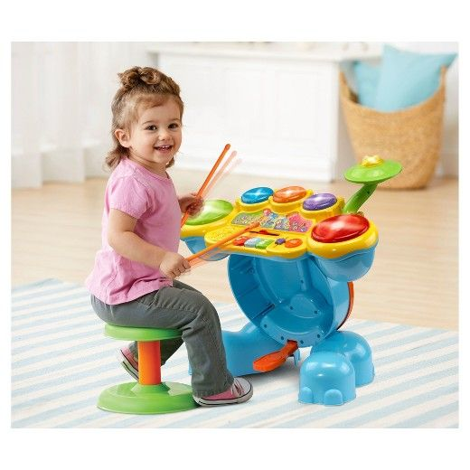 Let your little one set the tone with the Zoo Jamz Stompin' Fun Drums by VTech. Encourage your little rocker to be a star while they enhance creative thinking and motor skills by tapping out beats and creating their own sounds! Your child will enjoy this fresh way to practice counting and develop coordination as they follow along with the melodies and sing-along songs or create their own rockin' beats! Your mini musician will love stepping on the elephant bass pedal to see the elephan...