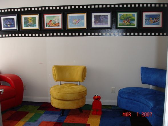 "Babies Movie Room, This room is for the toddlers to watch movies. We have used the ""filmstrip motif"" to display disney pictures. It is very ..."