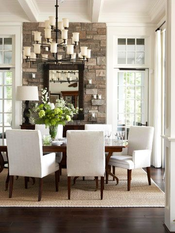 stone wall focal point, with the dark wood floors, crisp white walls