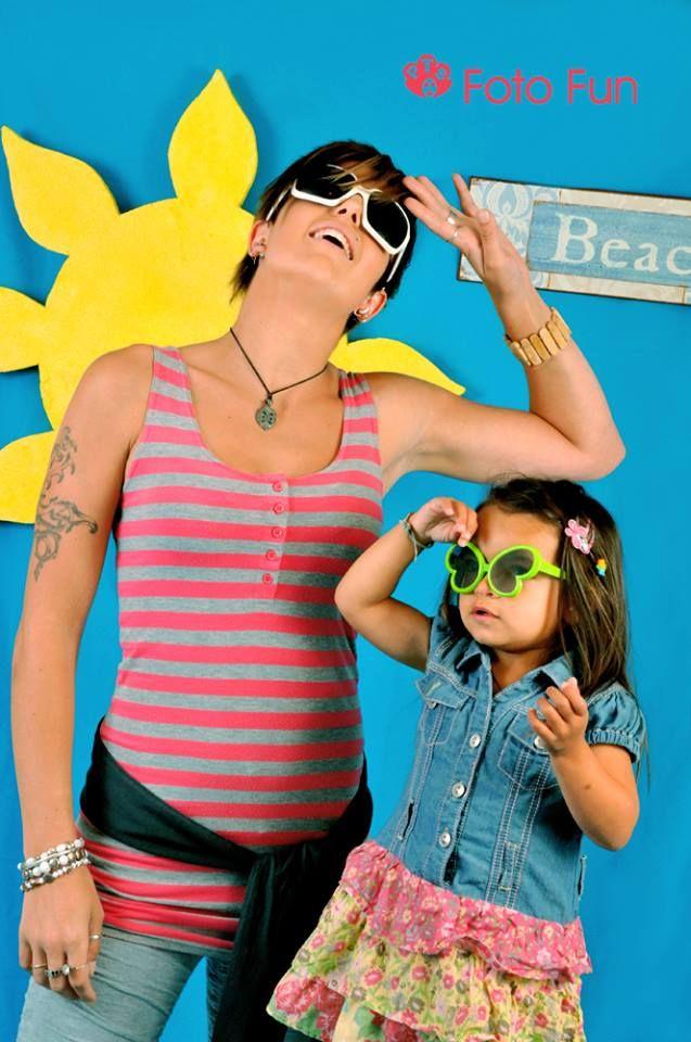 Mum and daughter having fun in a pretend beach