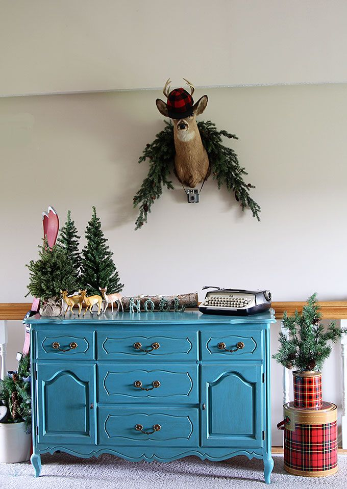 A fun and sassy vintage eclectic holiday home complete with a few kitschy blow molds, a small herd of plastic deer and plaid thermoses galore.