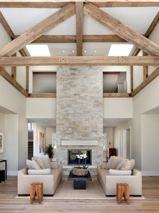 Ledger stone fireplace and Wood ceiling beams