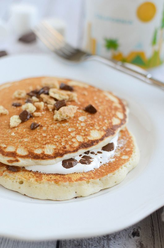 S'mores Pancakes! Graham cracker pancakes with marshmallow creme and chocolate in the middle!