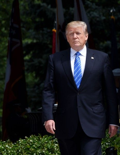 President Donald Trump participates in a wreath-laying ceremony at the Tomb of the Unknown Soldier at Arlington National Cemetery on Memorial Day, May 29, 2017 in Arlington, Virginia.