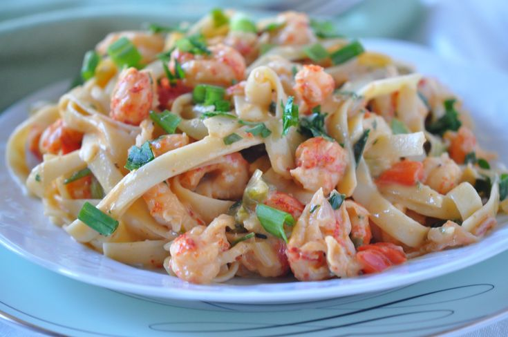 Best Crawfish Fettuccine ever with creamy& cheesy but healthier and easy to make.  My go to family favorite!  Can't wait for you to try this recipe if you LOVE crawfish  #crawfish www.hollyclegg.com