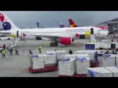 More than 100 passengers and crew escape down emergency chutes as plane ...