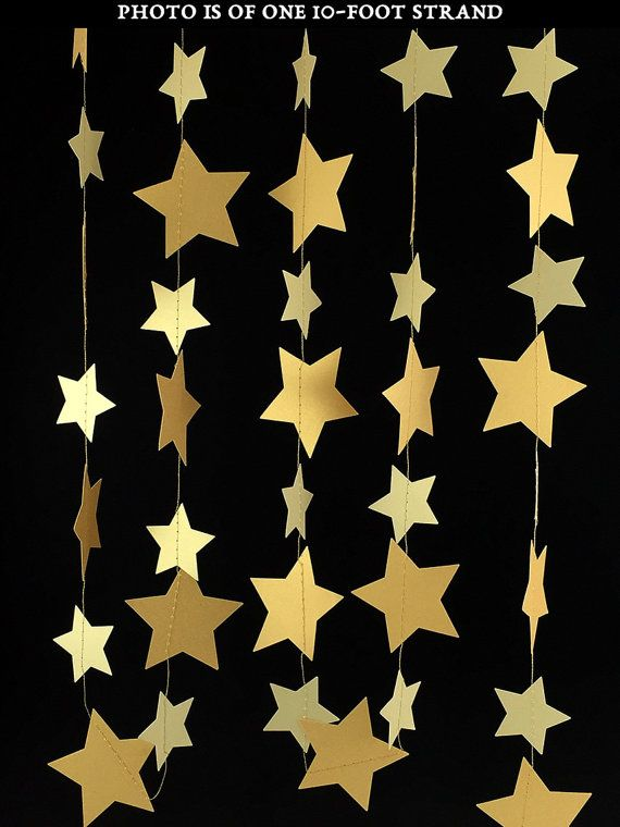 One strand of handmade garland that features two alternating sizes of stars in two shades of 105 lb. double-sided metallic gold cover stock. It is