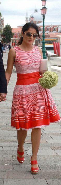 Salma Hayek    Dress – Carolina Herrera    Purse – Yves Saint Laurent    similar style bags by the same designer
