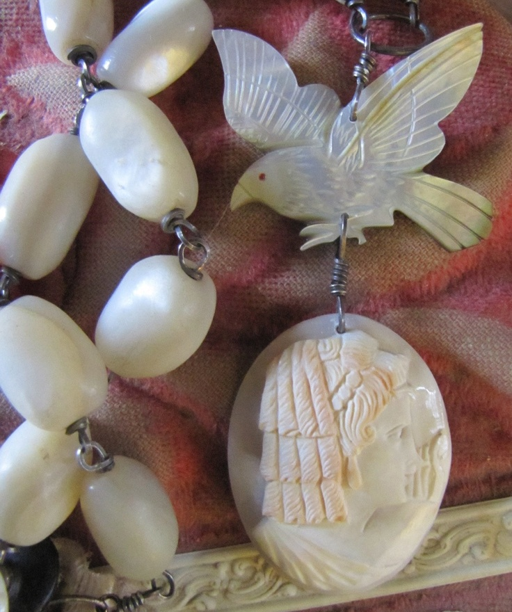 Mother of Pearl. Old carved mother of pearl bird and an antique shell cameo make the perfect pair on this mother of pearl necklace!