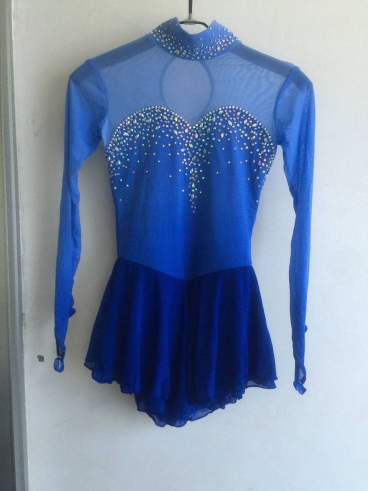 Pink, blue and red with sequins custom made figure skating competition dress from Nonstop Dancing. Description from ebay.com. I searched for this on bing.com/images