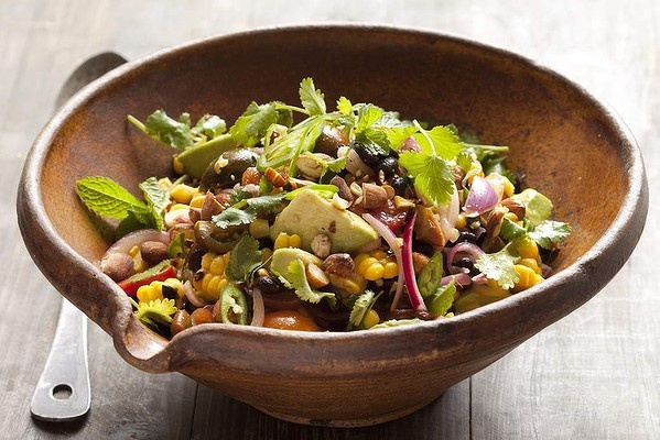 Caroline Velik's grilled sweet corn salad with black beans, avocado and almonds. Photo: Marina Oliphant