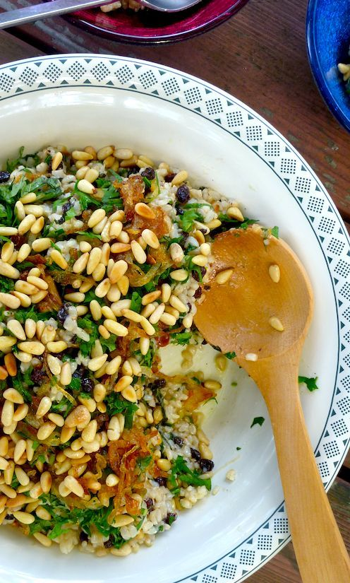 Brown rice, mint and pine nut salad with currants and caramelised onion