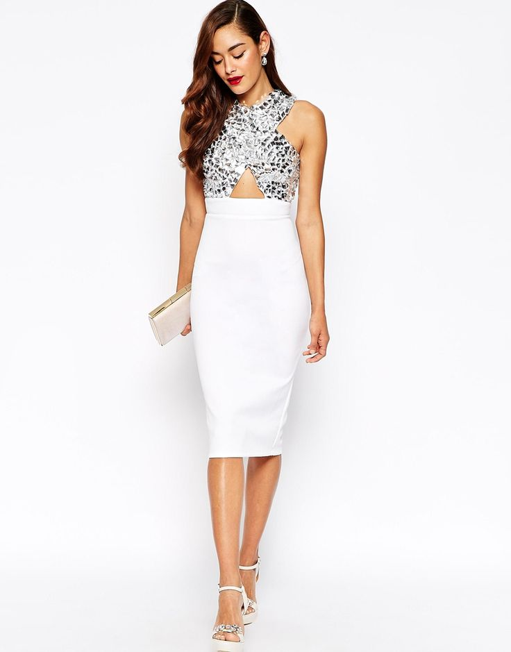 Perfect dress for any special occasion - White cocktail dress, white clutch & heeled sandals. Wavy brown hair.