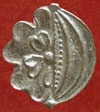 This attractive badge shows the Tudor rose and pomegranate joined together.  Replica pewter site