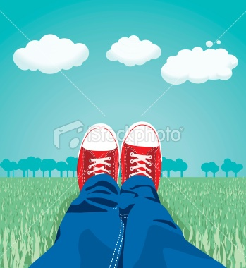 Sneakers on the meadow - Royalty Free Stock Vector Art Illustration