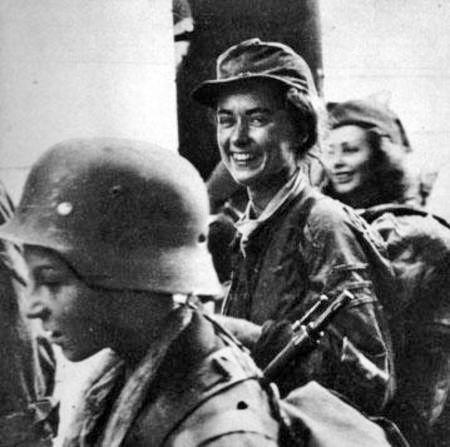 "Soldiers of the battalion ""Miotla"" on the street. Warecka. On the left side of Tadeusz Rajszczak ""Maszynka"". In the middle of Wieslawa Reiff ""Slawa""."