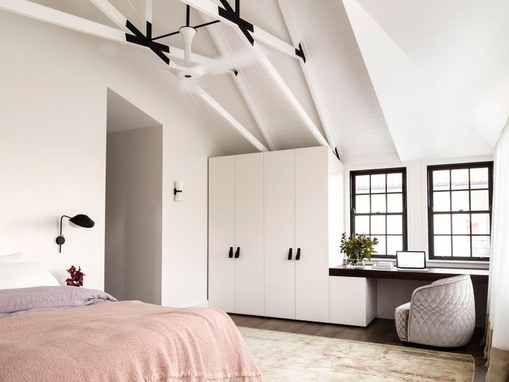 Luigi Rosselli Architects | Balancing Home | The light filled master bedroom has exposed rafters and steel reinforced trusses. | © Justin Alexander | #LuigiRosselliArchitects