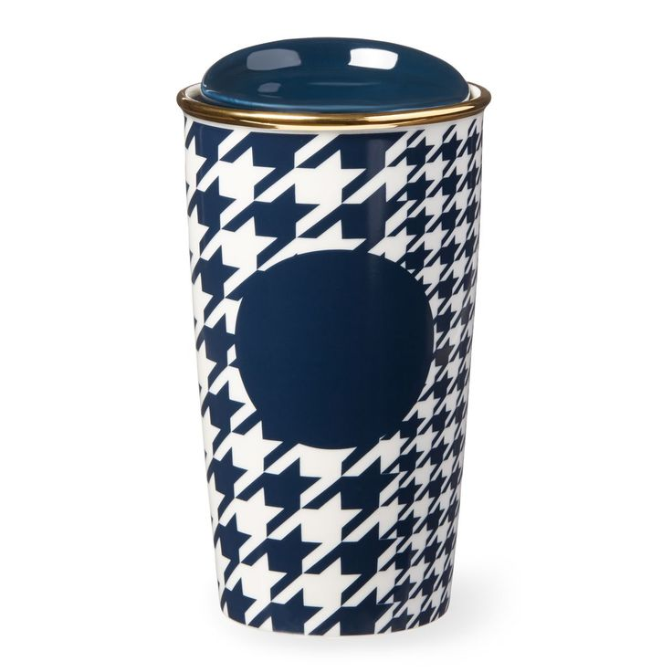 A ceramic travel mug featuring a checkered pattern with navy and gold accents.: