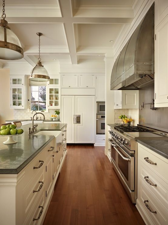 Spectacular kitchen featuring cream cabinets with gray countertops.