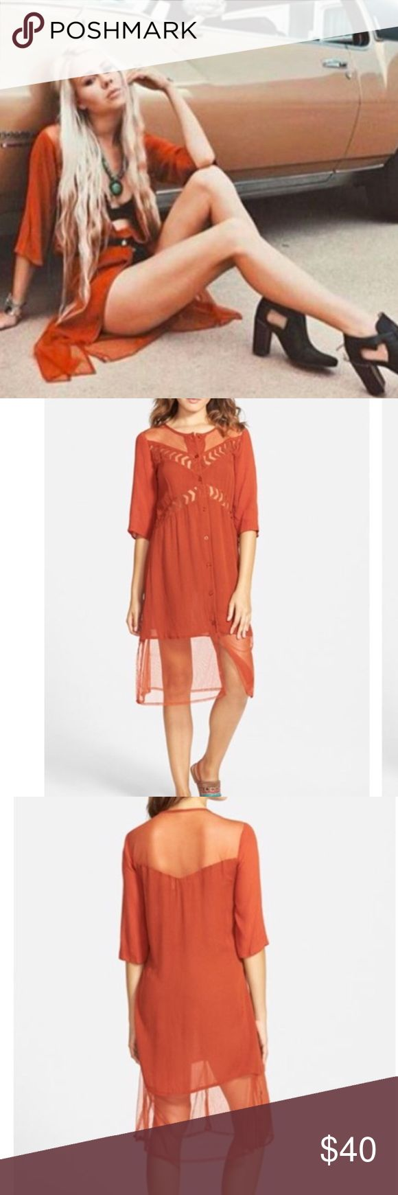 """Volcom Highway Child Boho Midi Dress Volcom Highway Child Boho Midi Dress. Sheer insets at the yoke and contrast hem lend flirty, skin-baring details to a shirtdress framed with chic elbow sleeves in this unique, super boho rusty color. Front button closure. 100% viscose. Approx. 40"""" long. Armpit to armpit approx. 18"""" across laying flat. Definitely has an oversized feel, so I think it'd work for XS-S IMO. Stock photo from Volcom catalogue shoot. Volcom Dresses Midi"""
