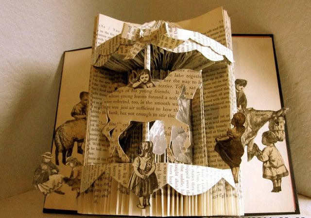 """Unknown Artist. """"3D Storytelling."""" Craft. Krrb. Krrb Inc., n.d. Web. 11 Jan 2016. http://blog.krrb.com/5-easy-pieces-recycled-book-art/        The words come to Life in this work. When we use our imagination while reading a story, the words form images in our mind. This reminds me of a pop out book."""