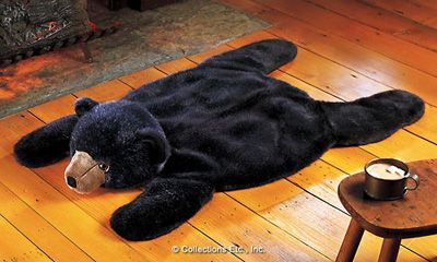 "Cozy up by the fire or snuggle up with a book and enjoy the creature comforts of this fuzzy fellow. Bring a little personality to your den and tickle your toes with furry plush. This irresistible bear is sure to be the favorite seat for people and pets alike. 20"" x 38"". Machine wash."