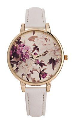 Weiße Armbanduhr mit botanischem Muster auf dem Zifferblatt