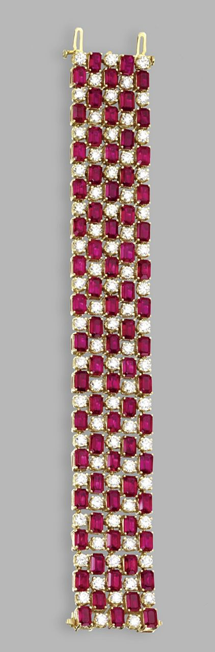 18 KARAT GOLD, RUBY AND DIAMOND BRACELET. Of lattice design set with emerald-cut rubies weighing 47.51 carats, and round diamonds weighing approximately 13.50 carats, length 7 inches.