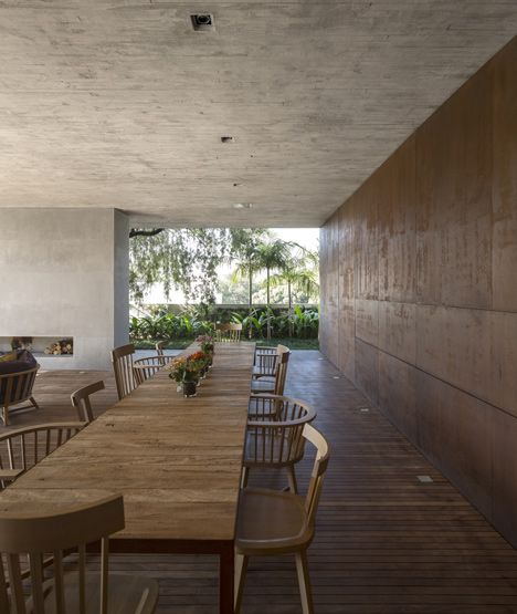 Interior dining area - wood flooring, concrete wall and ceiling, patina bronze accent wall.