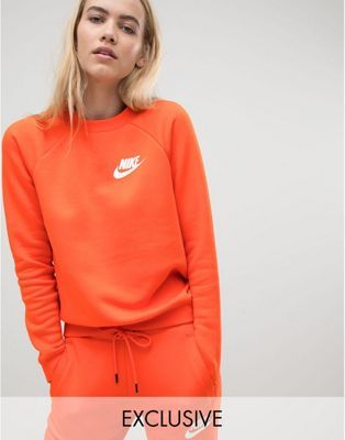0ae5c9529373 Nike Exclusive To ASOS Rally Sweatshirt In Orange