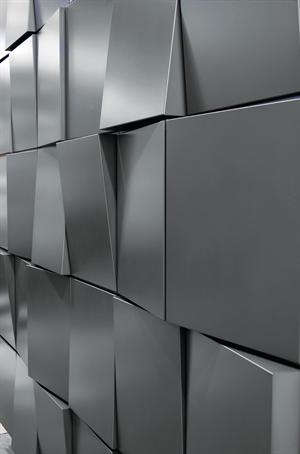 Dri-Design's new Tapered Series architectural metal wall panel system allows each panel face to taper top to bottom, bottom to top, left to right or right to left. Random or regimented patterns can be created. The series can be made out of painted aluminum, zinc, copper and stainless steel.
