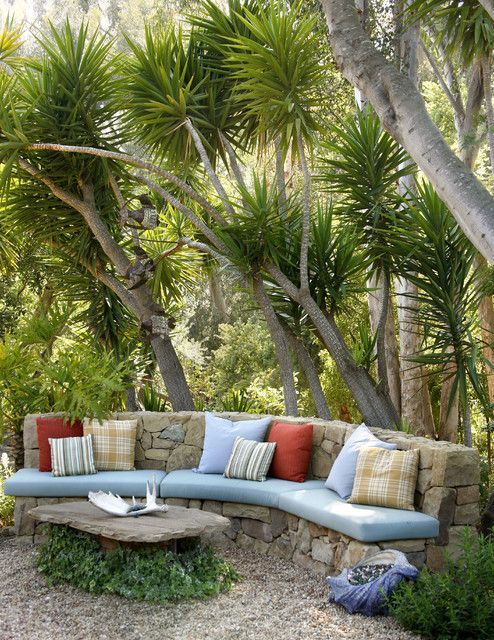 awesome backyard design - the link is to a company that does chairs and cushions and such, like the ones here, but I love the custom stone bench for the garden area as well.