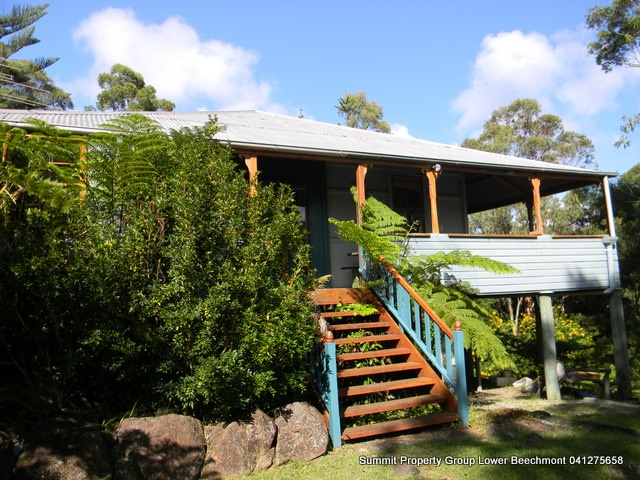 Character Home featuring 3 beds + study 1 bathroom. Oozing with charm  hardwood floors, 18ft timber ceilings, fans throughout, Beechmont is a community based caring country town where you can live the lifestyle and still be only 20 minutes from Nerang or 30 mins from Robina Town Centre. School bus at the end of the street and 2 mins to Binna Burra bush walks in the Lamington National Park, coffee at the tea house or dine in the Lodge.