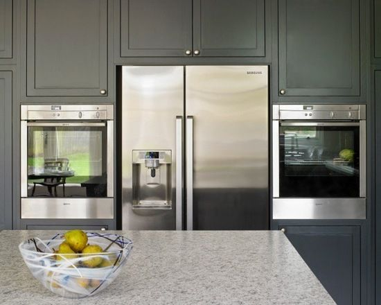 Esher blue kitchen with built in appliances - American style fridge freezer and wall-mounted ovens.