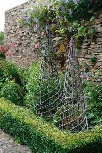 Garden obelisks for the clematis I want to grow...metal or wood? I can't decide. #gardening