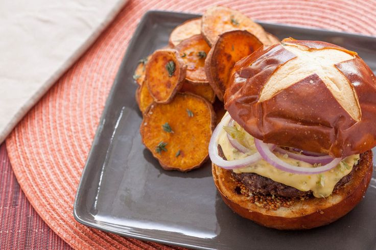 Short Rib Burgers on Pretzel Buns  with Hoppy Cheddar Sauce & Roasted Sweet Potato Rounds (recipe)