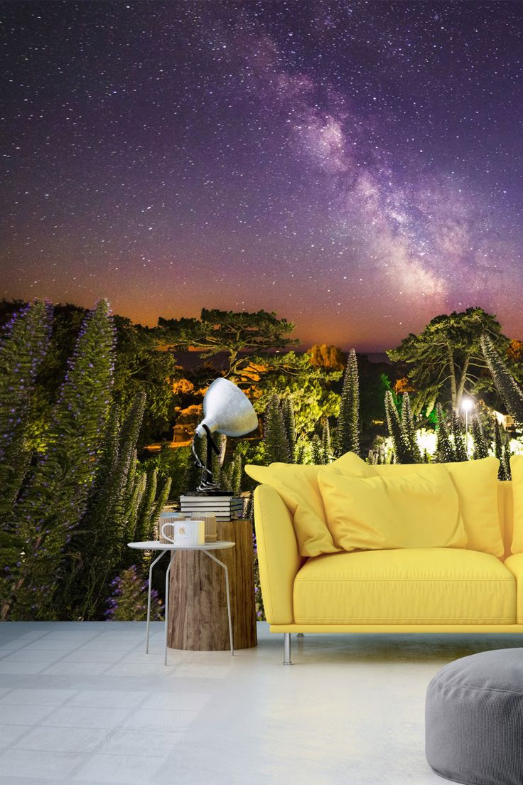 This stunning starry night sky is a dreamy take on a standard tree wallpaper. Mural in picture: Mirrored universe tree wallpaper