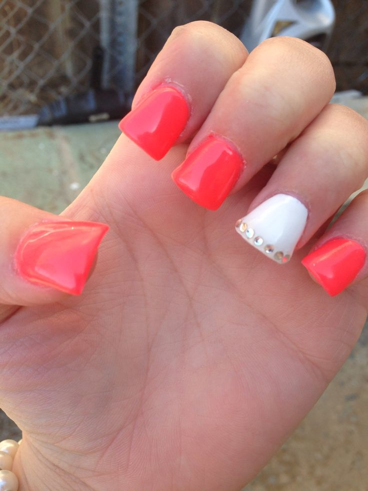 Coral pink nails with rhinestones