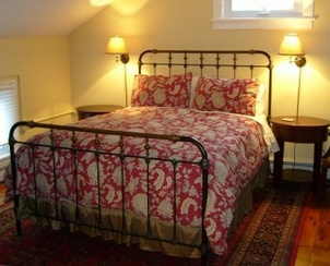 Cast Iron or tarnished brass bed.