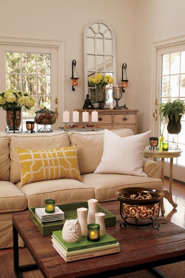 55 Decorating Ideas for Living Rooms | Like some of these ideas here, but especially like the stack of books on coffee table with 3 vases, a candle, and an owl or put in a tray!