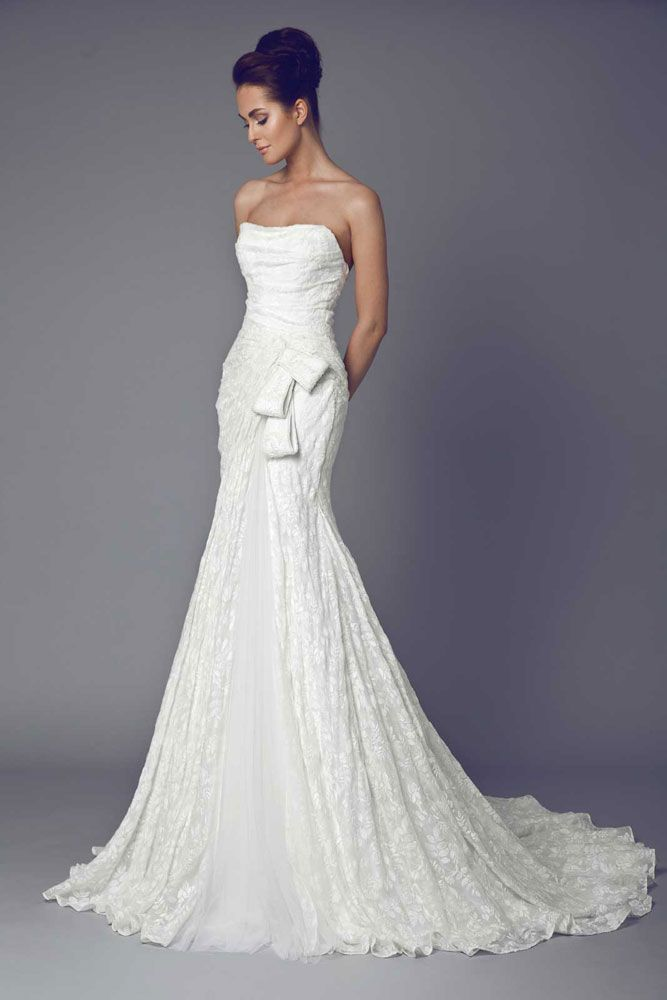 Strapless embroidered Silk Gazar gown with a Tulle slit and a bow shape on the hipline. - More info at: http://www.efr7.com/shop/the-bride/lysa/
