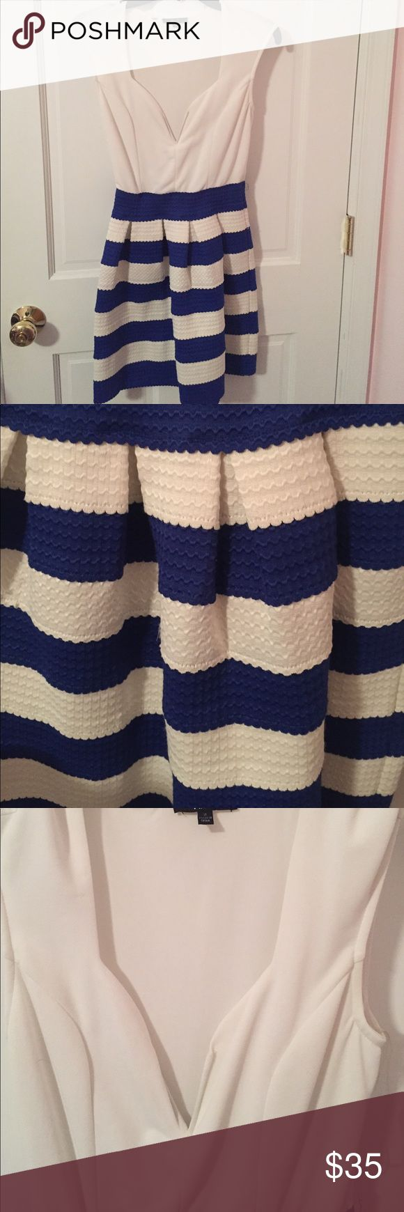 Amazing Striped Pleated Sundress Worn once to a horse race! Can be dressed up with heels or down with sandals!! Absolutely stunning.the top is tight and can hold boobs in place without a bra (always a plus), while the skirt part is pleated, and is puffed out ever so slightly. It really is beautiful on and accentuates a body, creating an hour glass figure Dresses